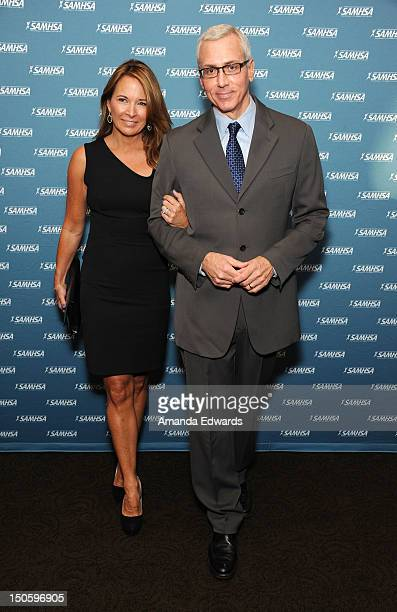 Addiction specialist Dr Drew Pinsky and his wife Susan Pinsky arrive at The Substance Abuse And Mental Health Services Administration 2012 Voice...