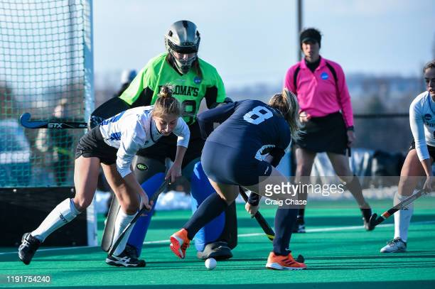Addie Peters of Franklin Marshall left tries to dispossess Isabel Chandler of Middlebury dribbles during the Division III Women's Field Hockey...