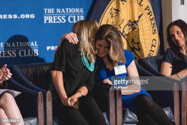 Addie Zinone gets a hug from Gloria Rivera after telling her story of sexual harrassment as panelist Eleanor McManus looks on at the Press Forward...