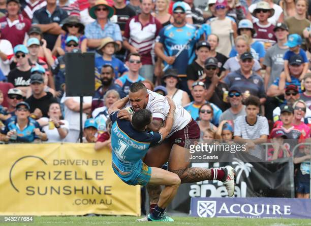 Addin FonuaBlake of Manly collides with Michael Gordon of the Titans during the round five NRL match between the Gold Coast Titans and the Manly Sea...