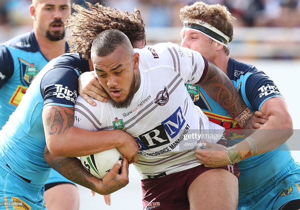 Addin Fonua-Blake of Manly (middle) is stopped by Kevin Proctor and Jarrod Wallace of the Titans during the round five NRL match between the Gold Coast Titans and the Manly Sea Eagles at Marley Brown Oval on April 8, 2018 in Gladstone, Australia.