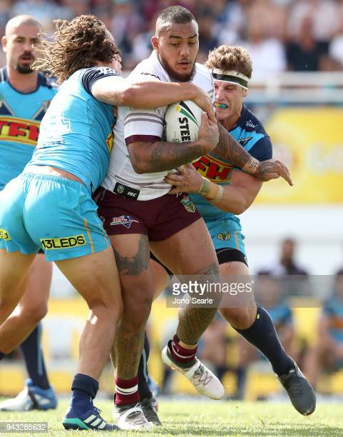 Addin FonuaBlake of Manly is stopped by Kevin Proctor and Jarrod Wallace of the Titans during the round five NRL match between the Gold Coast Titans...