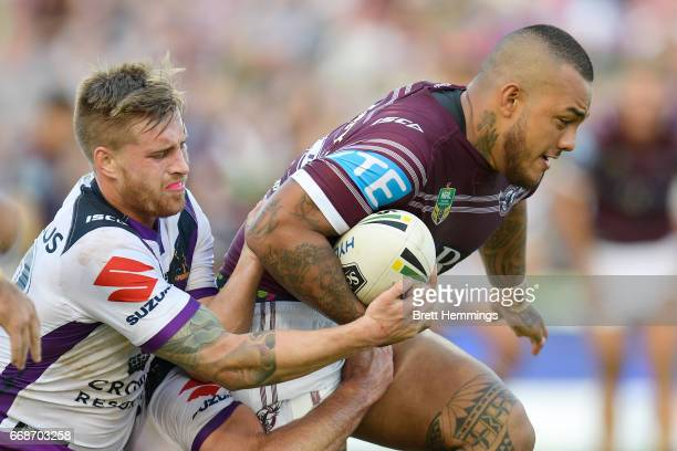 Addin FonuaBlake of Manly is tackled during the round seven NRL match between the Manly Sea Eagles and the Melbourne Storm at Lottoland on April 15...