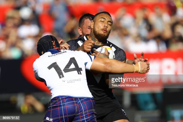 Addin FonuaBlake of New Zealand is tackled during the 2017 Rugby League World Cup match between the New Zealand Kiwis and Scotland at AMI Stadium on...
