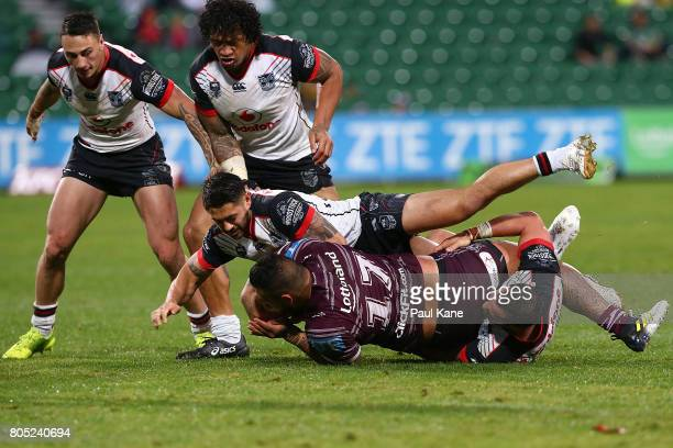 Addin FonuaBlake of the Sea Eagles gets tackled during the round 17 NRL match between the Manly Sea Eagles and the New Zealand Warriors at nib...