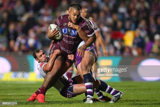 Addin FonuaBlake of the Sea Eagles is tackled by Cameron Smith of the Storm during the round 18 NRL match between the Manly Sea Eagles and the...
