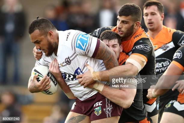 Addin FonuaBlake of the Sea Eagles is tackled by during the round 23 NRL match between the Wests Tigers and the Manly Sea Eagles at Leichhardt Oval...