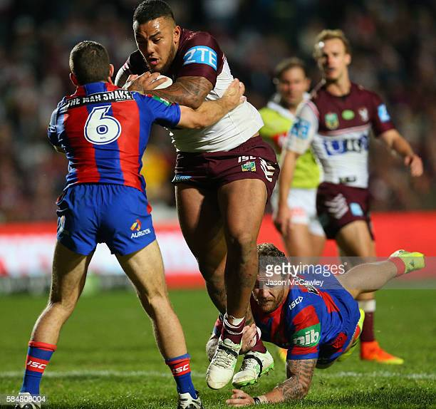 Addin FonuaBlake of the Sea Eagles is tackled by Jack Cogger and Korbin Sims of the Knights during the round 21 NRL match between the Manly Sea...