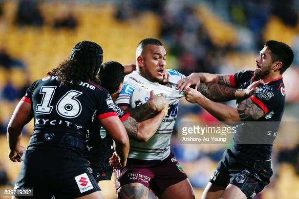 Addin FonuaBlake of the Sea Eagles is tackled by Shaun Johnson of the Warriors during the round 25 NRL match between the New Zealand Warriors and the...