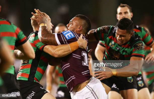 Addin FonuaBlake of the Sea Eagles is tackled during the NRL trial match between the Manly Sea Eagles and the South Sydney Rabbitohs at Campbelltown...