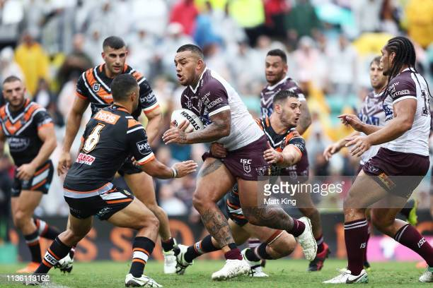 Addin Fonua-Blake of the Sea Eagles is tackled during the round 1 NRL match between the Wests Tigers and the Manly Warringah Sea Eagles at Leichhardt...