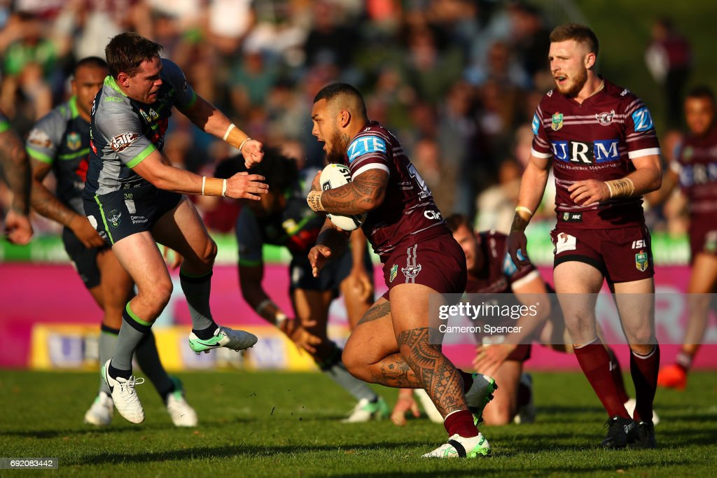 Addin Fonua-Blake of the Sea Eagles is tackled during the round 13 NRL match between the Manly Sea Eagles and the Canberra Raiders at Lottoland on June 4, 2017 in Sydney, Australia.