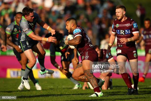 Addin FonuaBlake of the Sea Eagles is tackled during the round 13 NRL match between the Manly Sea Eagles and the Canberra Raiders at Lottoland on...