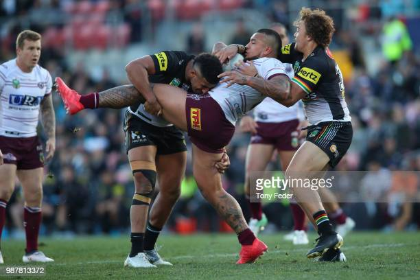 Addin FonuaBlake of the Sea Eagles is tackled during the round 16 NRL match between the Penrith Panthers and the Manly Sea Eagles at Panthers Stadium...