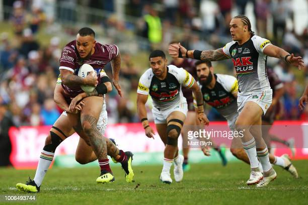 Addin FonuaBlake of the Sea Eagles is tackled during the round 20 NRL match between the Manly Sea Eagles and the Penrith Panthers at Lottoland on...