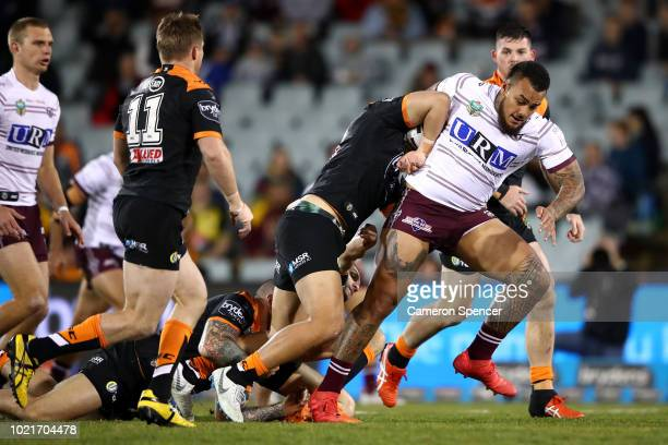 Addin FonuaBlake of the Sea Eagles is tackled during the round 24 NRL match between the Wests Tigers and the Manly Sea Eagles at Campbelltown Sports...