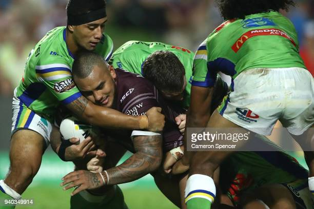 Addin FonuaBlake of the Sea Eagles is tackled during the round four NRL match between the Many Sea Eagles and the Canberra Raiders at Lottoland on...