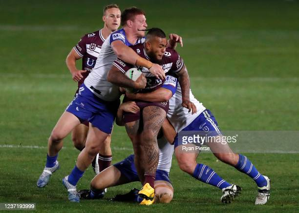 Addin Fonua-Blake of the Sea Eagles is tackled during the round three NRL match between the Manly Sea Eagles and the Canterbury Bulldogs at Central...