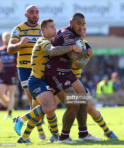 Addin FonuaBlake of the Sea Eagles is tackled during the round two NRL match between the Manly Sea Eagles and the Parramatta Eels at Lottoland on...