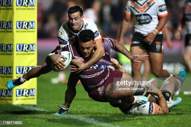 Addin FonuaBlake of the Sea Eagles scores a try during the round 22 NRL match between the Manly Sea Eagles and the Wests Tigers at Lottoland on...