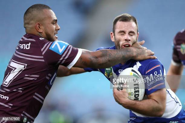 Addin FonuaBlake of the Sea Eagles tackles Matt Frawley of the Bulldogs during the round 24 NRL match between the Canterbury Bulldogs and the Manly...