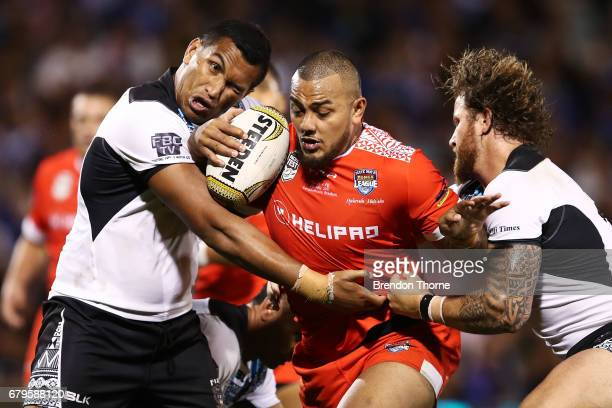 Addin FonuaBlake of Tonga is tackled by the Fijian defence during the 2017 Pacific Test Invitational match between Tonga and Fiji at Campbelltown...