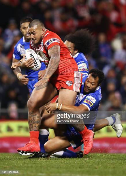 Addin FonuaBlake of Tonga is tackled by the Samoan defence during the 2018 Pacific Test Invitational match between Tonga and Samoa at Campbelltown...