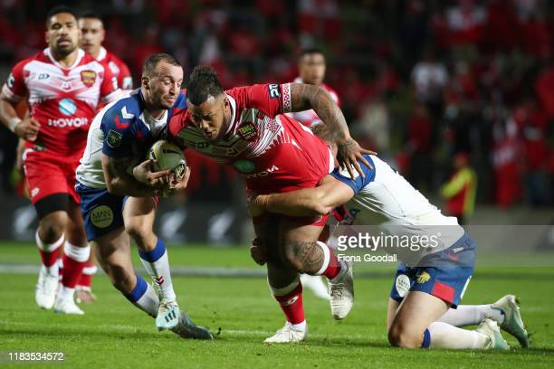 Addin FonuaBlake of Tonga is tackled during the International Rugby League Test match between the Great Britain Lions and Mate Ma'a Tonga at FMG...