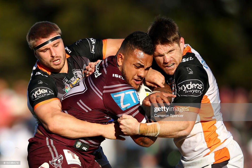 Adding Fonua-Blake of the Sea Eagles is tackled during the round 19 NRL match between the Manly Sea Eagles and the Wests Tigers at Lottoland on July 16, 2017 in Sydney, Australia.
