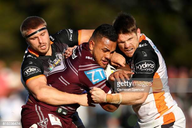 Adding FonuaBlake of the Sea Eagles is tackled during the round 19 NRL match between the Manly Sea Eagles and the Wests Tigers at Lottoland on July...