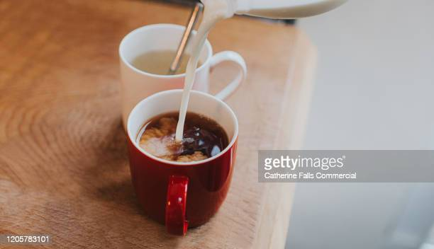 adding milk to tea - kettle stock pictures, royalty-free photos & images
