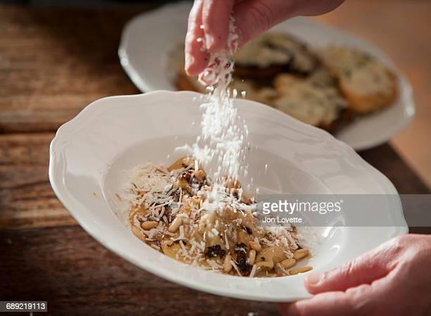 Adding Parmigiano-Reggiano to Pasta
