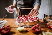 Adding Raspberries To Tasteful Blackberry Pie