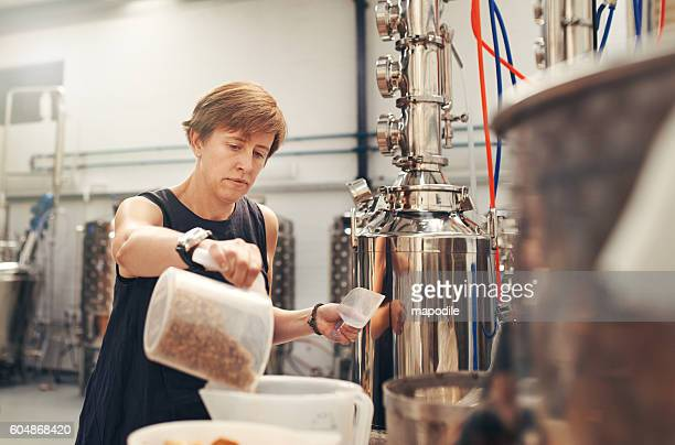 Adding the best sourced barley to her batch