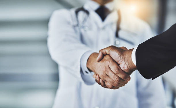 adding the corporate factor to healthcare - drug approval stock pictures, royalty-free photos & images