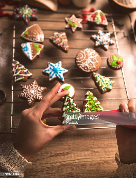 Adding the Icing on Baked Gingerbread Christmas tree Cookie
