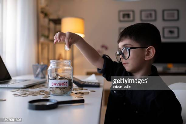 adding up his coins - bringing home the bacon stock pictures, royalty-free photos & images