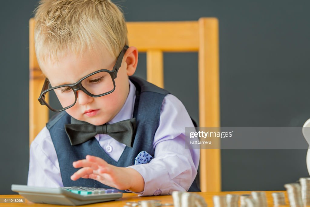 Adding Up His Coins : Stock Photo