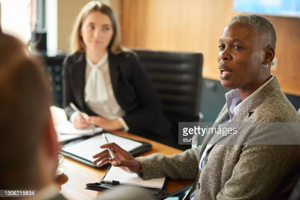 adding value to the meeting - young women stock pictures, royalty-free photos & images