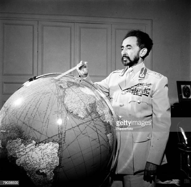 Addis Ababa Ethiopia Africa Emperor Haile Selassie the King of Abyssinia is pictured standing by his illuminated globe of the world