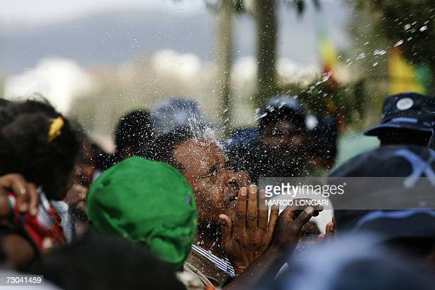 An Ethiopian Orthodox is splashed with blessed water 19 January 2006 at the beginning of the Timqat celebrations in Addis Ababa Timqat or Epiphany is...