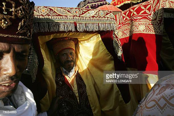 An Ethiopian Orthodox priest parades a Tabot which symbolises the Ark of the Covenant 18 January 2007 during the beginning of the celebration of the...