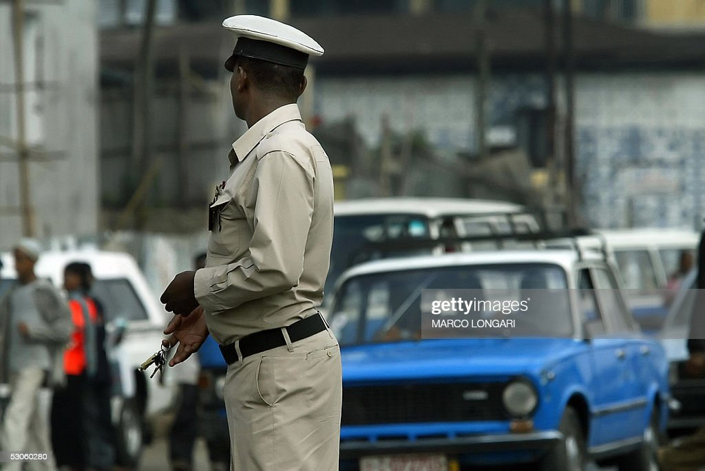 An Ethiopian traffic policeman works 13 June 2005 at a busy