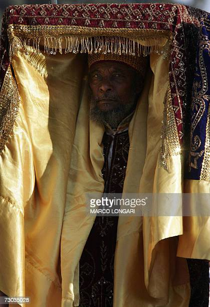 Ethiopian Orthodox priest carry a Tabot which symbolises the Ark of the Covenant 18 January 2007 during the beginning of the celebration of the...