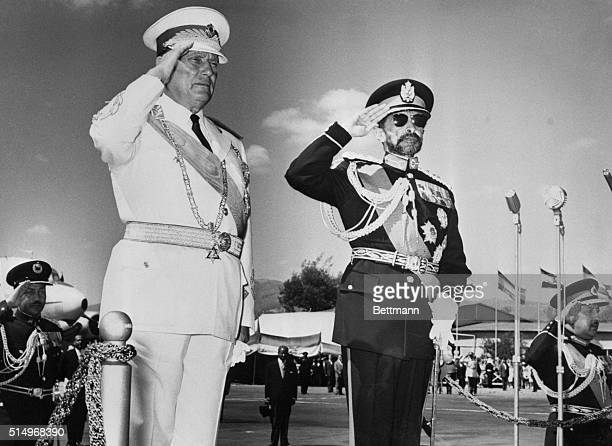 Greets and Salutations Standing on a raised reviewing stand Yugoslavia's President Tito and Ethiopian Emperor Haile Selassie salute parading troops...