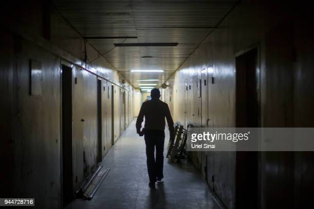 Professor Yannis Pitsiladis walks in a hallway at the Addis Ababa university on September 25 2015 in Addis Ababa Ethiopia
