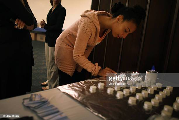 Addisa Goldman lights candles during a community Passover Seder at Beth Israel synagogue on March 25 2013 in Miami Beach Florida The community...