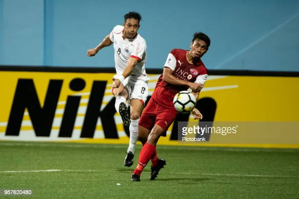 Addison Oliveira of Persija Jakarta is challenged by Jumaat Jantan of Home United during the AFC Cup Zonal Semi final between Home United and Persija...