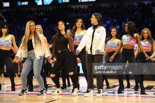 Addison Rae Easterling Charli D'Amelio and Dixie D'Amelio dance during a timeout during NBA AllStar Saturday Night Presented by State Farm as part of...