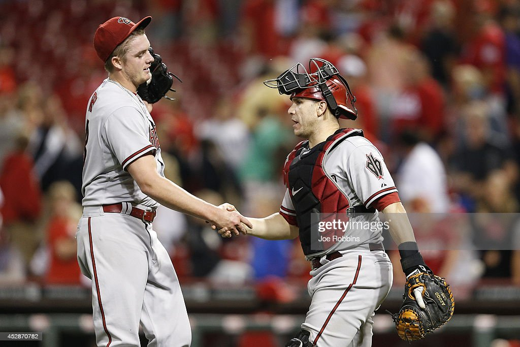 Addison Reed #43 and Miguel Montero #26 of the Arizona Diamondbacks celebrate after the final out of the game against the Cincinnati Reds at Great American Ball Park on July 28, 2014 in Cincinnati, Ohio. The Diamondbacks won 2-1 in 15 innings.